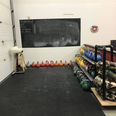 The other half of the training area for BJJ members